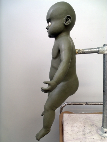 Final changeling baby sculpt full body side view