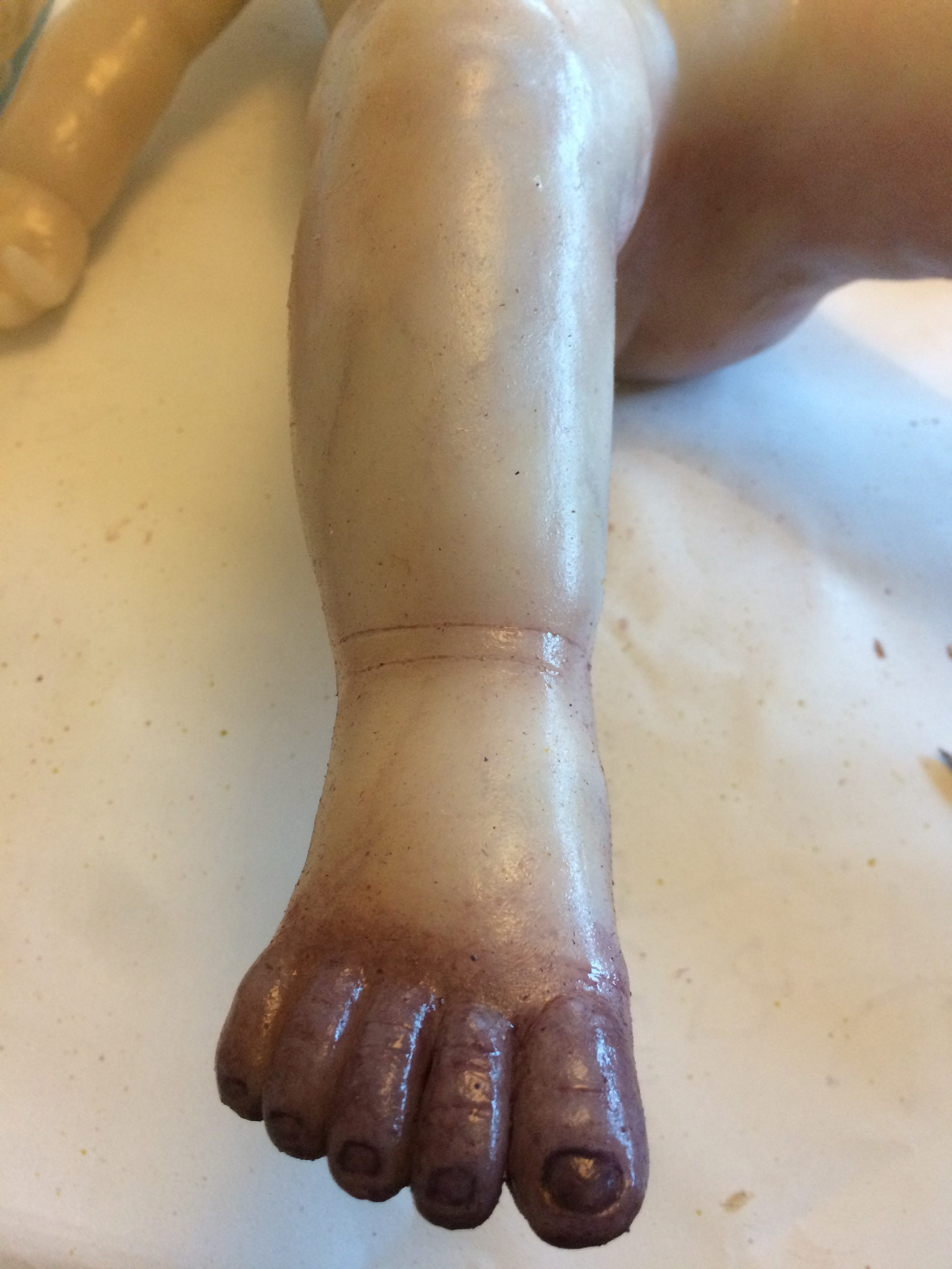 Painting silicone cast foot oil paint