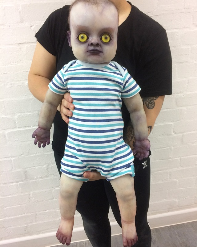 Finished and dressed full body changeling baby prop