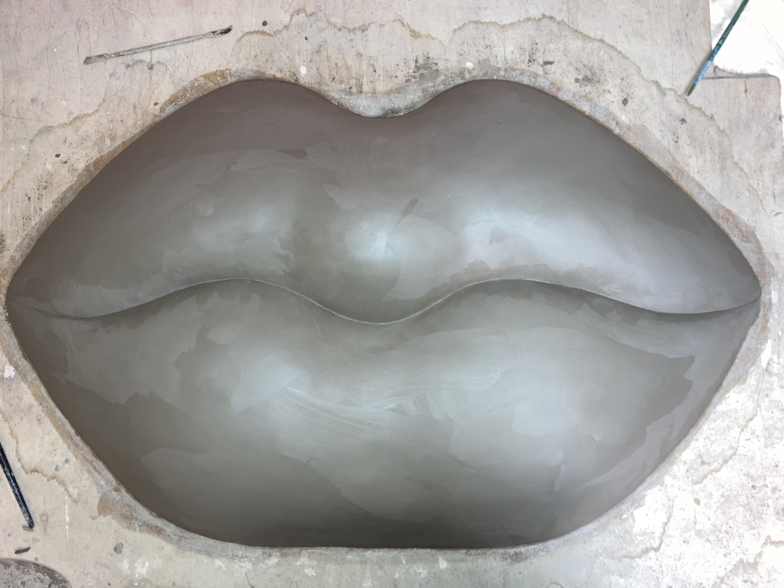 giant lips sculpture clay